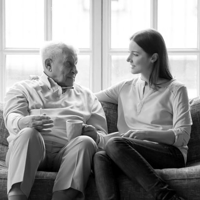 woman and elder man talking