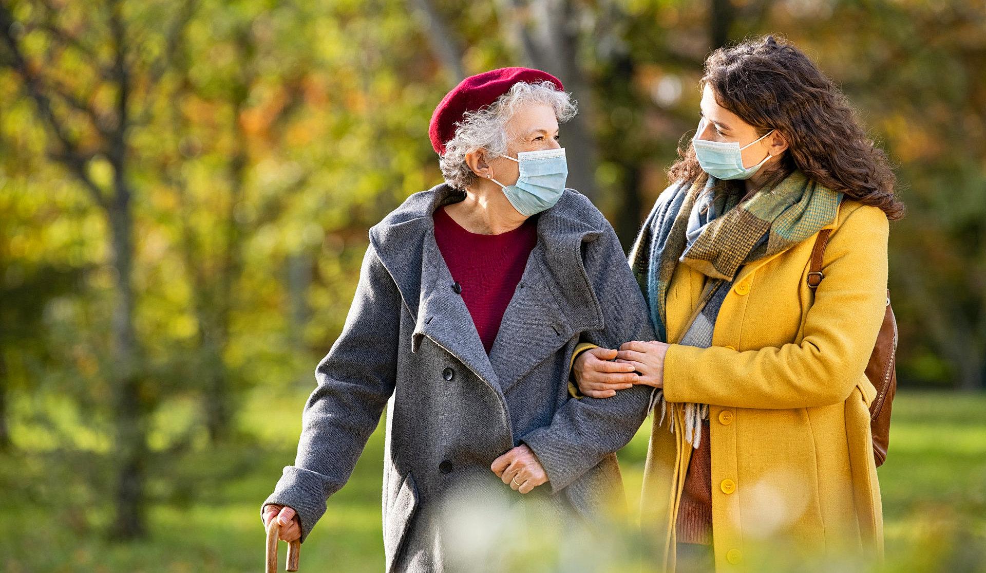 woman and elder lady walking