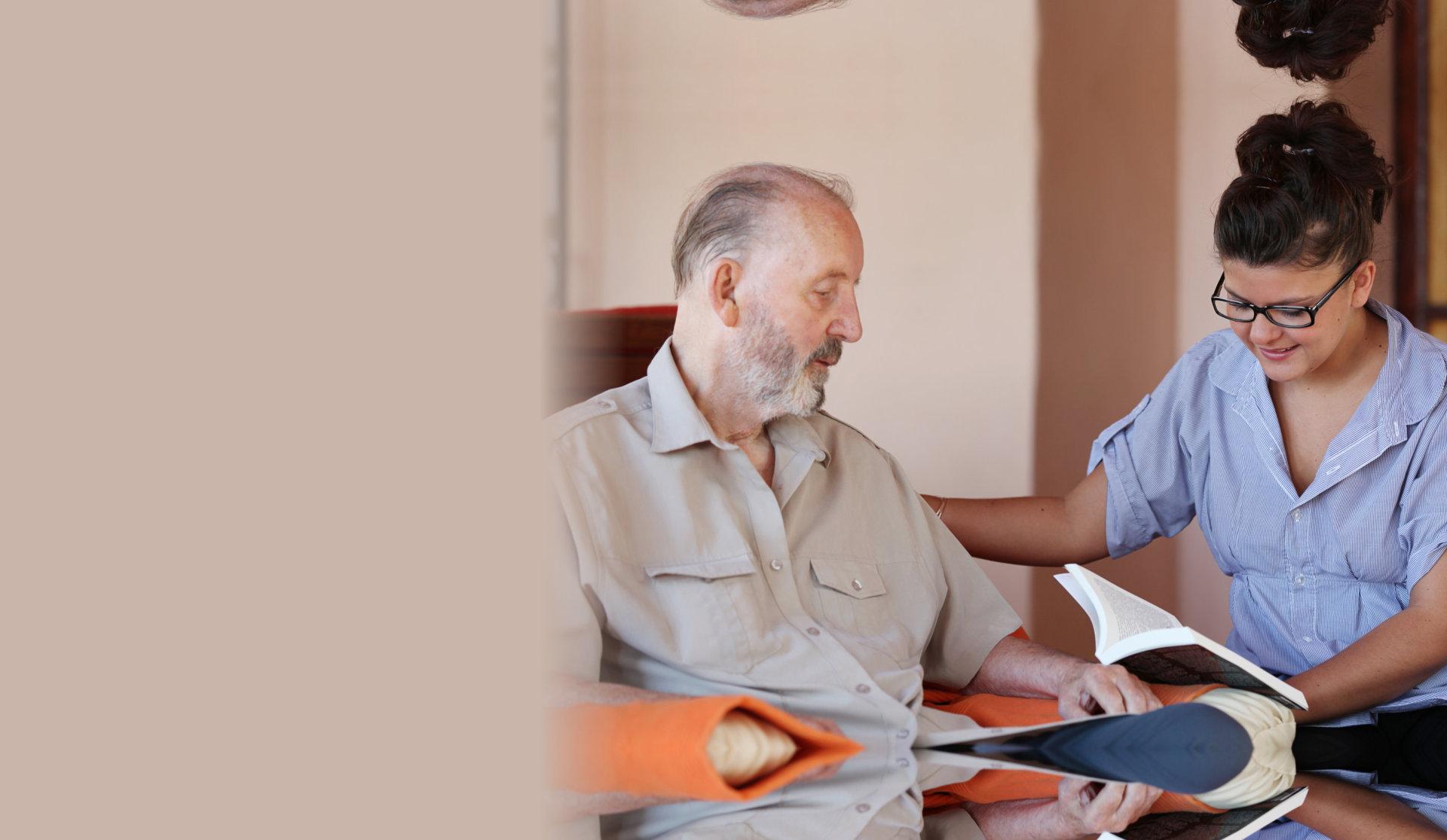 caretaker reads book to elder man